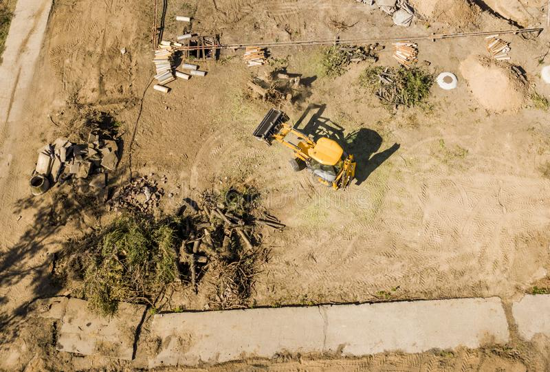 Top aerial view of big wheel loader excavator bulldozer work on a building project f royalty free stock image