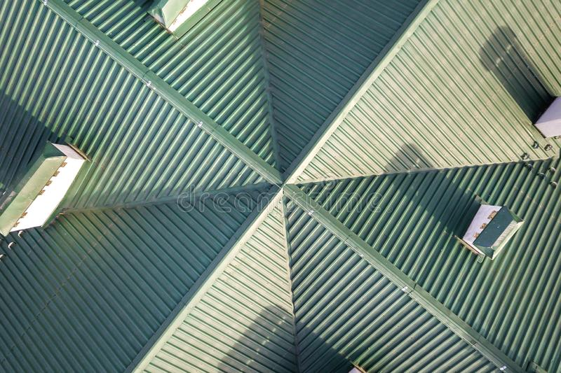Top aerial view of building green shingle tiled roof construction. Abstract background, geometrical pattern.  royalty free stock photography