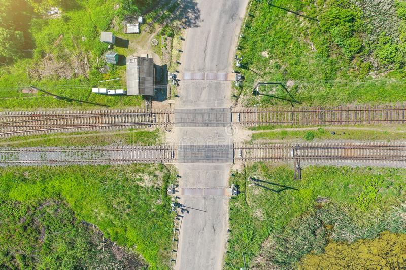 Top aerial view of the empty railway crossing and crossing the road barrier.  royalty free stock images