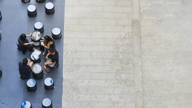 top aerial view of people sit and talk picnic in pedestrian street stock photo
