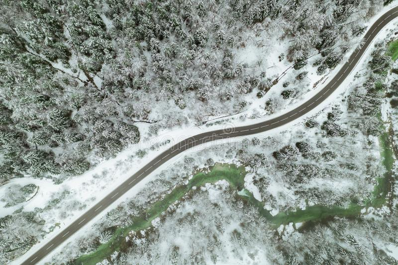 Top aerial view of snow mountain landscape with trees and road. Austria stock images