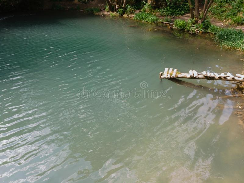 Top Aerial wide view of paradise water glas surface in Deep forest blue lagoon. texture background. Travel tour concept, nature stock photos