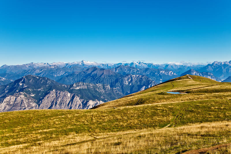 Download At the top of the Alps stock image. Image of green, cloud - 21571717