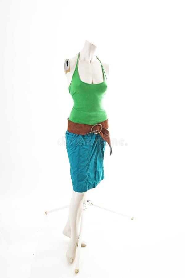 Top azul del verde de la falda en la exhibición completa del body shop del maniquí Estilos de la moda de la mujer, ropa en el fon imágenes de archivo libres de regalías