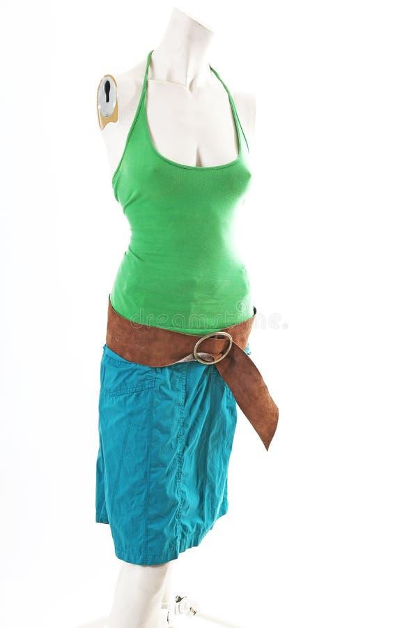 Top azul del verde de la falda en la exhibición completa del body shop del maniquí Estilos de la moda de la mujer, ropa en el fon foto de archivo