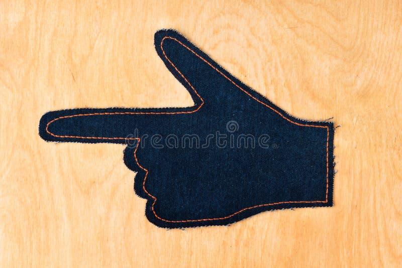 Top besk?dar Symbolisk handpekare som göras av grov bomullstvill royaltyfria bilder