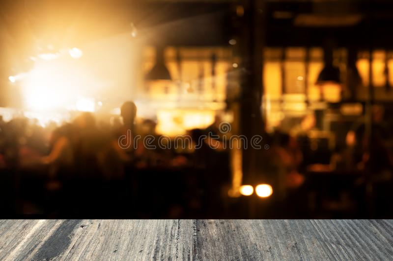Top of black table in bar and pub party with lamp light night life background. Top of black table in blur bar and pub party with lamp light night life background stock images