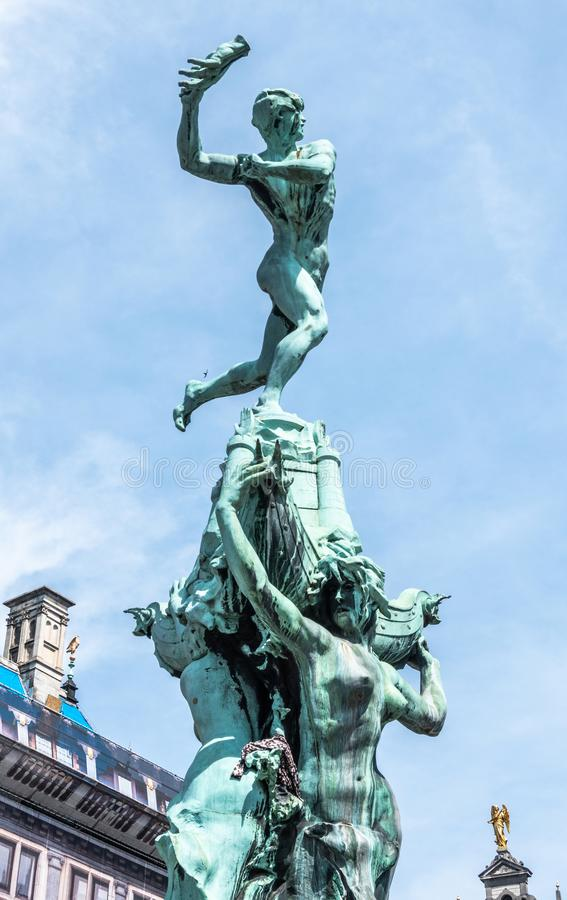 Top of Brabo Statue in Antwerpen, Belgium. Antwerpen, Belgium - June 23, 2019: Top of Green bronze Brabo statue on Grote Markt, with historic houses  gables in royalty free stock photography