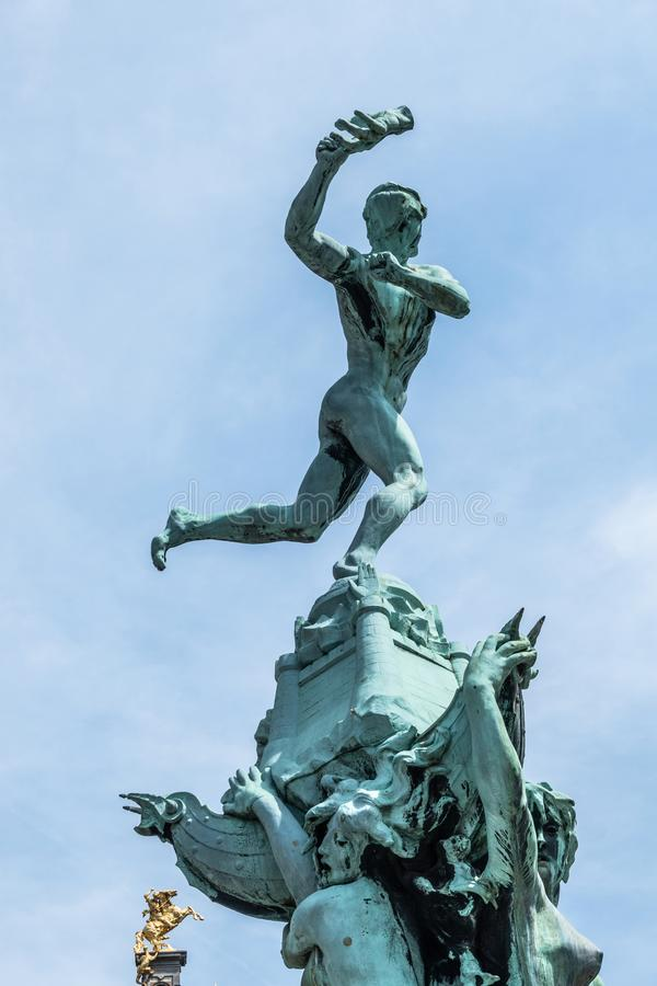 Top of Brabo Statue in Antwerpen, Belgium. Antwerpen, Belgium - June 23, 2019: Top of Green bronze Brabo statue on Grote Markt under blue sky. Golden Horse of royalty free stock image