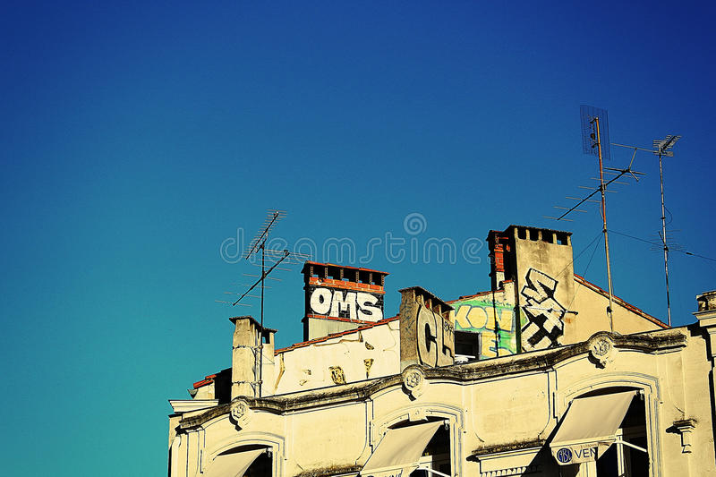 Top of a building with grafitti stock photo