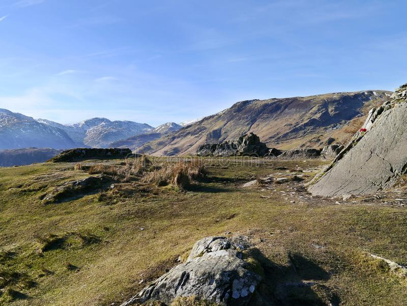 Top of Castle Crag on a great morning. On Castle Crag with memorial on the right stock photography