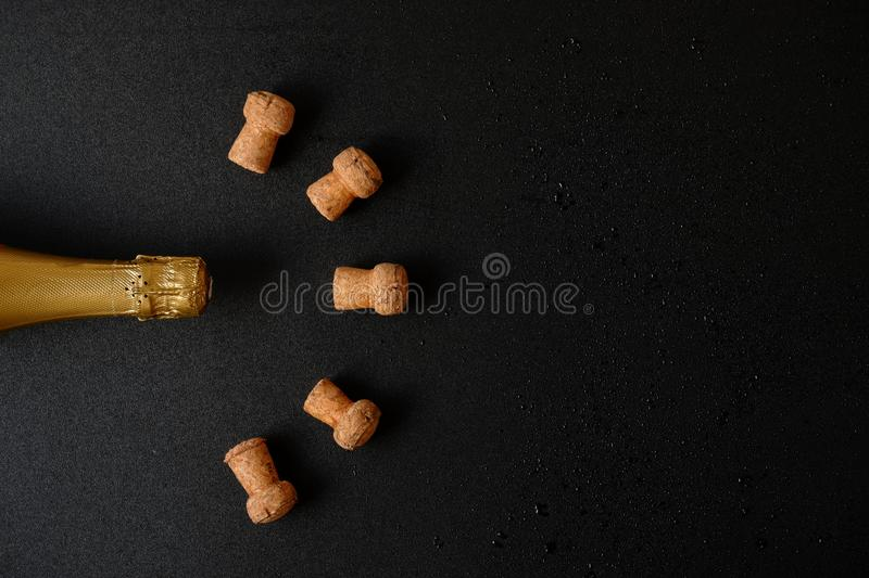 Top on champagne bottle with cork stoppers. Golden top on champagne bottle with cork stoppers and drops stock image