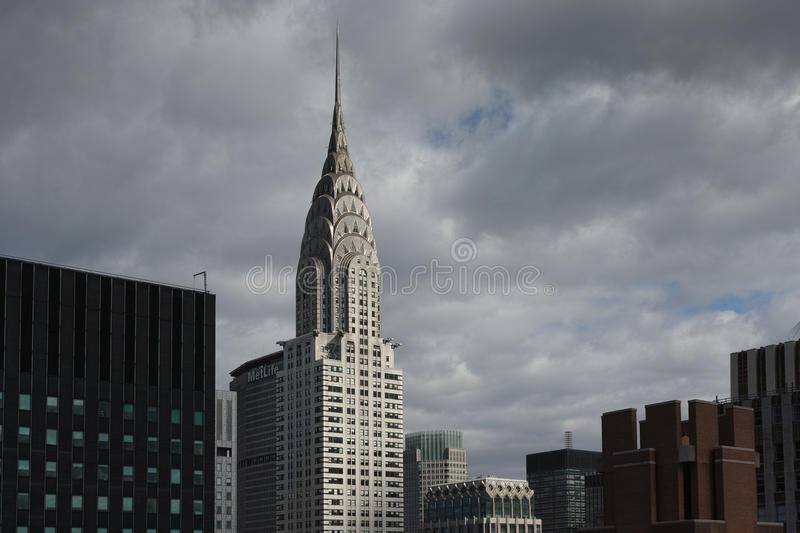 Top of Chrysler and other Manhattan midtown buildings with dark royalty free stock photos