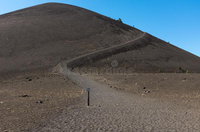 At the top of Cinder Cone, Lassen National Park looking up from the bottom of the winding trial towards the summit. stock images