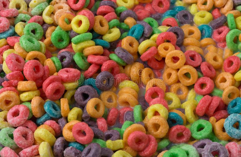 Close view of sugar coated fruity flavored cereal with milk royalty free stock images
