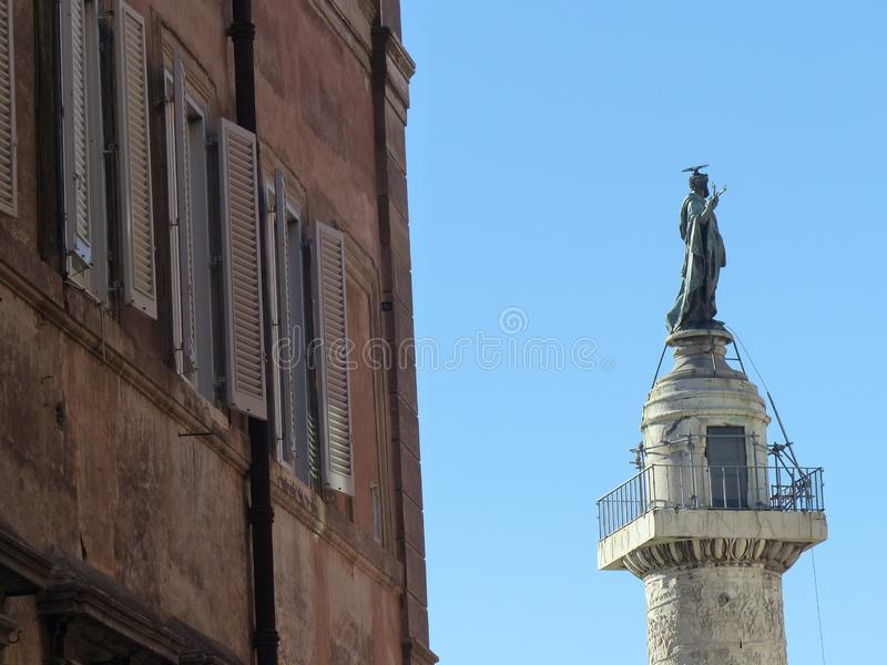 Top of a column with the statue of Imperor Trajan to Rome in Italy. royalty free stock photo