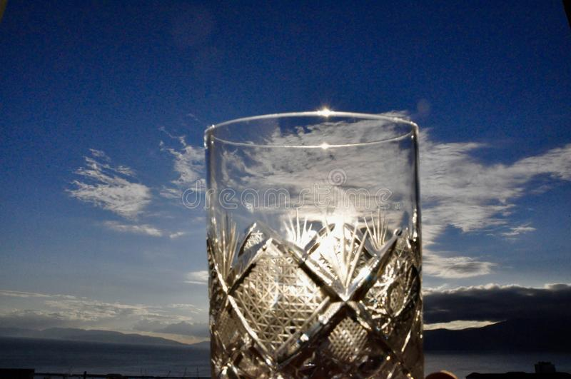 Having whiskey in the Chrystal glass. On the top of Croatia having a Chrystal glass of royalty free stock images