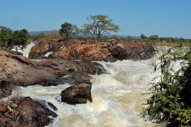 Puesta del sol en la cascada de Ruacana, Namibia imagen de archivo libre de regalías