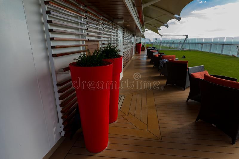 Top Deck and Tall Red Pots Aboard Celebrity Eclipse Cruise stock image