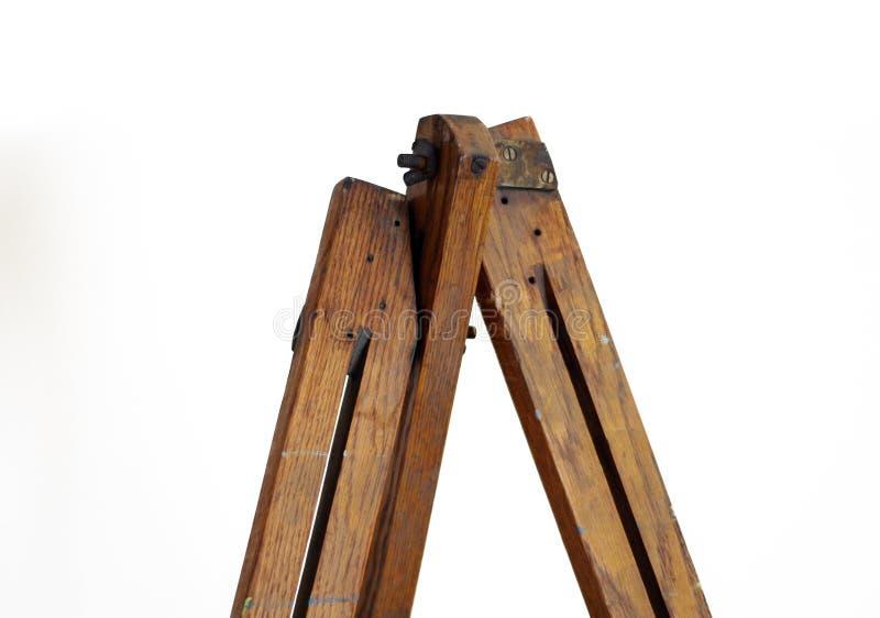 Top del caballete de la pintura con los pernos y las nueces de ala en agai de madera envejecido imagenes de archivo