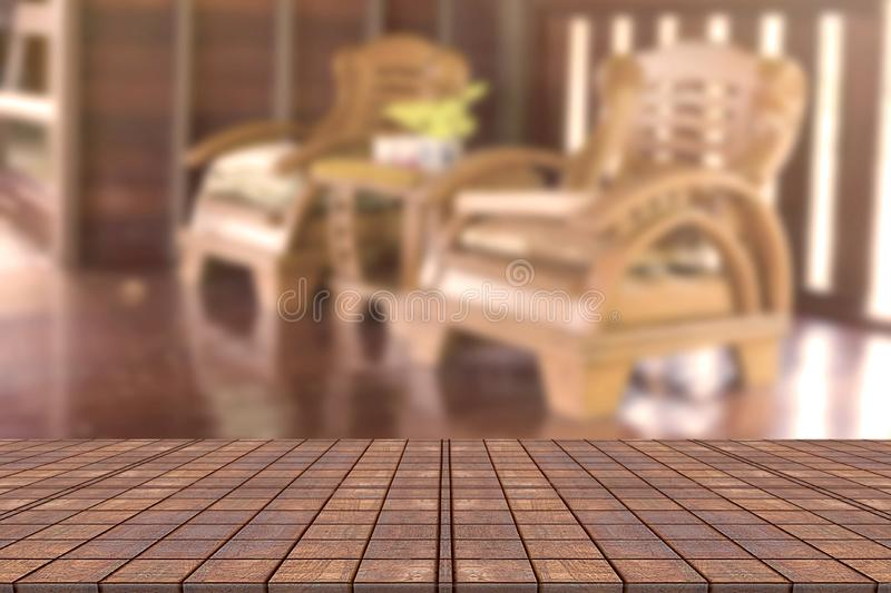 Top desk with blur living room background,wooden table royalty free stock images