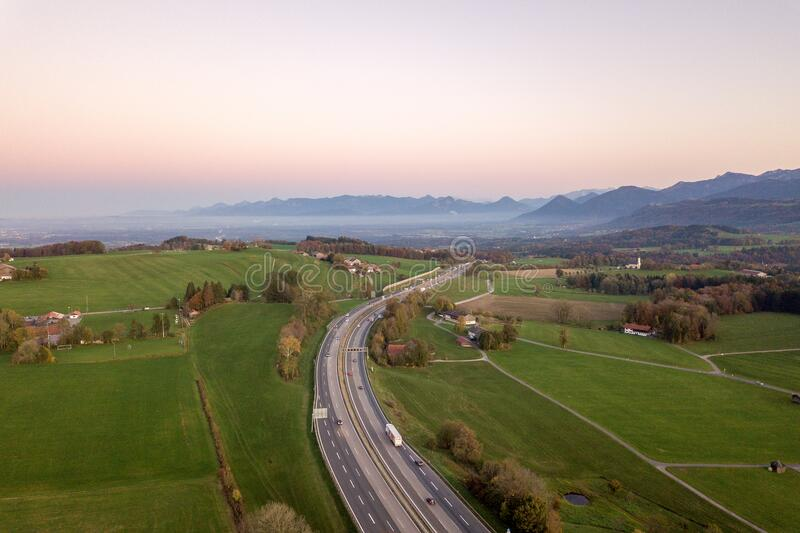 Top down aerial view of freeway interstate road with moving traffic cars in rural area.  stock photos