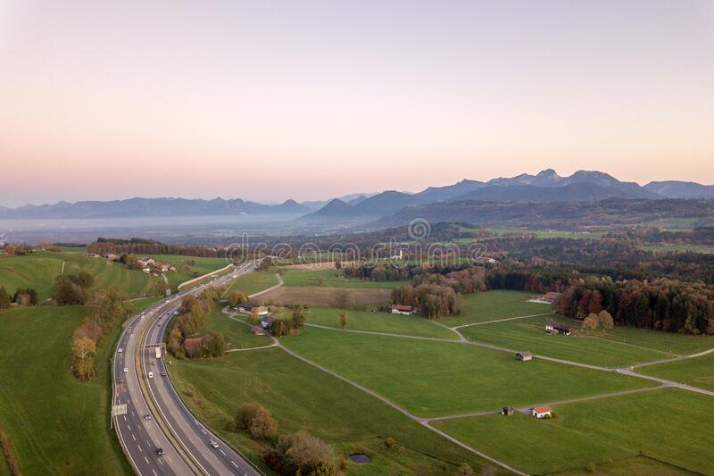 Top down aerial view of freeway interstate road with moving traffic cars in rural area.  royalty free stock image