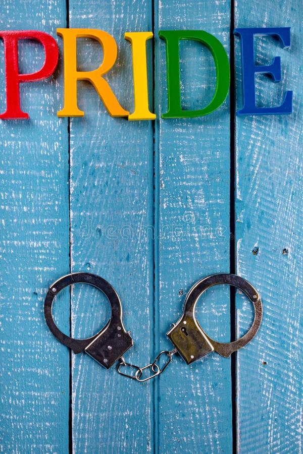 Top down photo of Gay Pride concept. Top down image showing Pride spelt in coloured letters on a blue wooden background royalty free stock photos