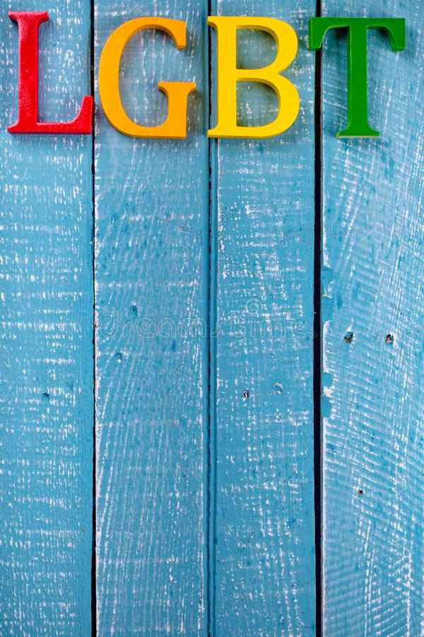 Top down photo of Gay Pride concept. Top down image showing LGBT spelt in coloured letters on a blue wooden background royalty free stock images