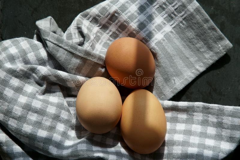 Brown eggs on a napkin. stock images
