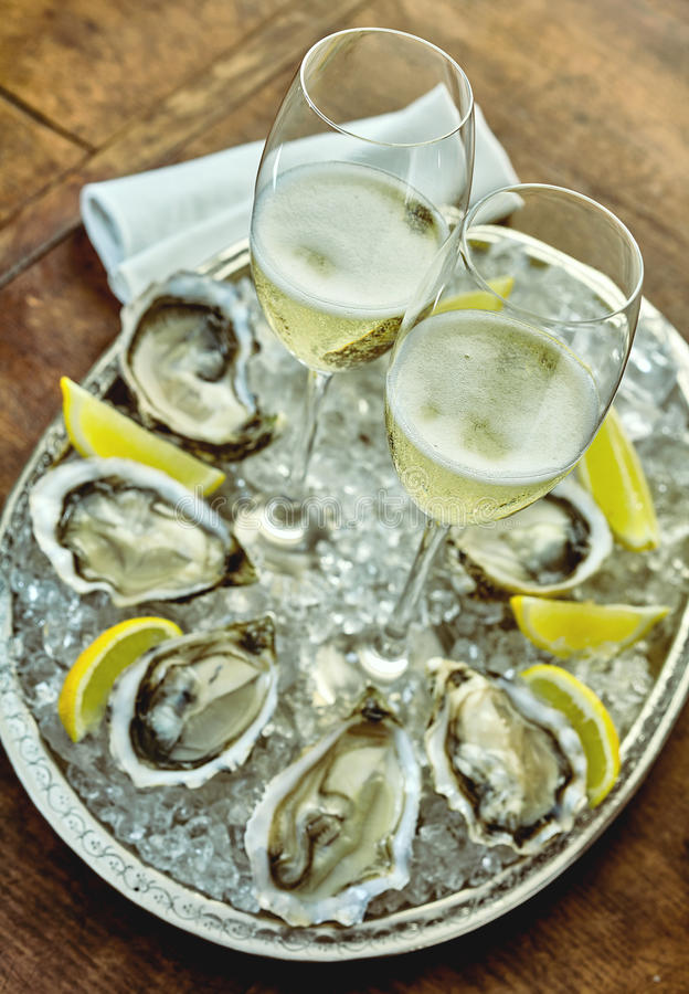 Top down view of champagne and mollusks stock images