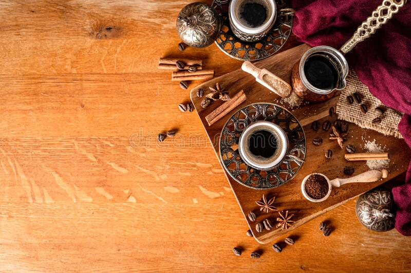 Top down view of a coffee table arrangement on wood background with space for text royalty free stock photo