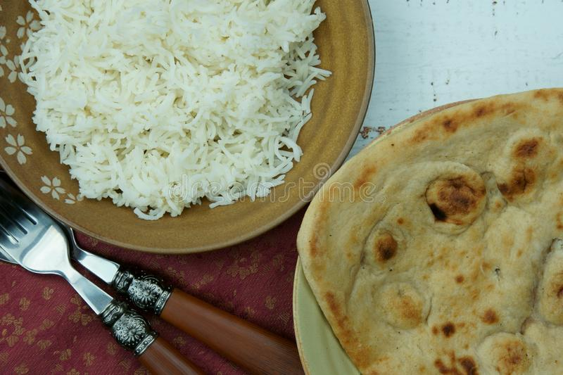 Top down view of extra long Basmati rice with Tandoori Roti or Indian Naan bread. Asia, pakistani, ethnic, mughlai, homemade, keto, healthy, gastronomy stock images