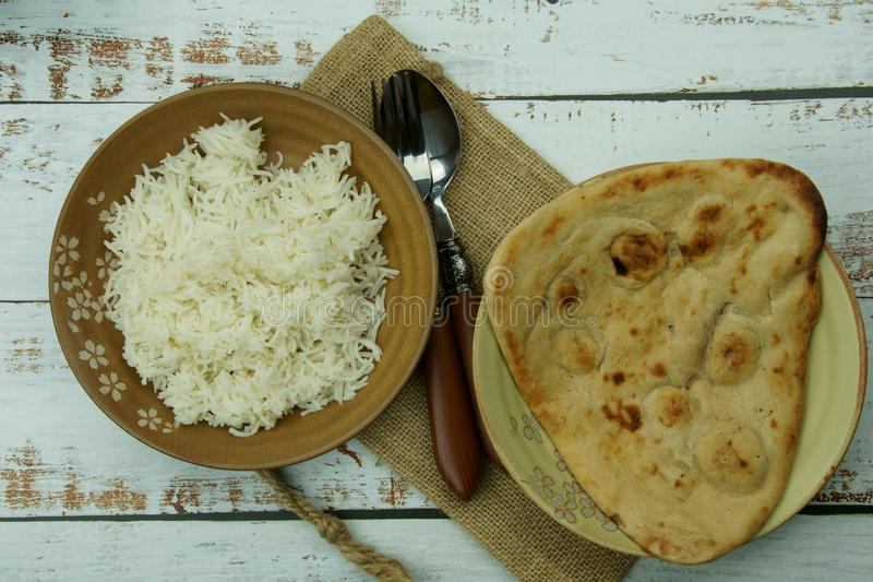 Top down view of extra long Basmati rice with Tandoori Roti or Indian Naan bread. Asia, pakistani, ethnic, mughlai, homemade, keto, healthy, gastronomy royalty free stock images