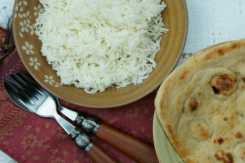 Top down view of extra long Basmati rice with Tandoori Roti or Indian Naan bread. Asia, pakistani, ethnic, mughlai, homemade, keto, healthy, gastronomy stock photography