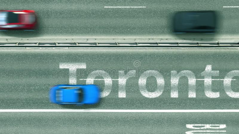 Top down view of the highway with revealing Toronto text. Driving in Canada 3D rendering. Aerial top down view of the highway with revealing text. Car travel stock illustration