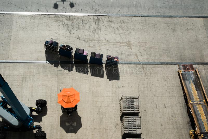 Luggage train top down view. Top down view of a luggage cart train on a concrete tarmac. Luggage and baggage carrier for travel on an airplane or cruiseline royalty free stock photos