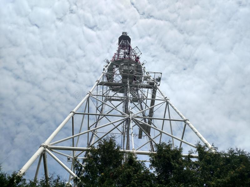 Top-down view of the telecommunication tower Overview botton on construction with down to top Sky with white clouds stock images