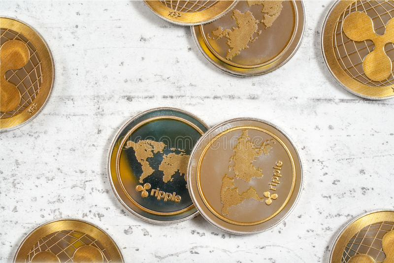 Top down view, XRP ripple cryptocurrency golden coins on white stone like board.  stock photography