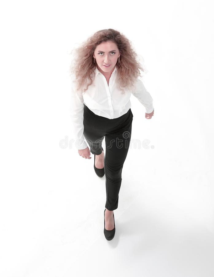 Executive business woman goes forward. From the top.Executive business woman goes forward royalty free stock photos