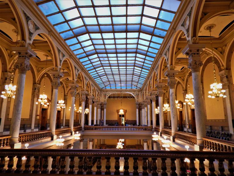Top Floor at the Indiana State House. An expansive skylight tops this 3 story wing of the 1878 Indiana State House in Indianapolis stock photos