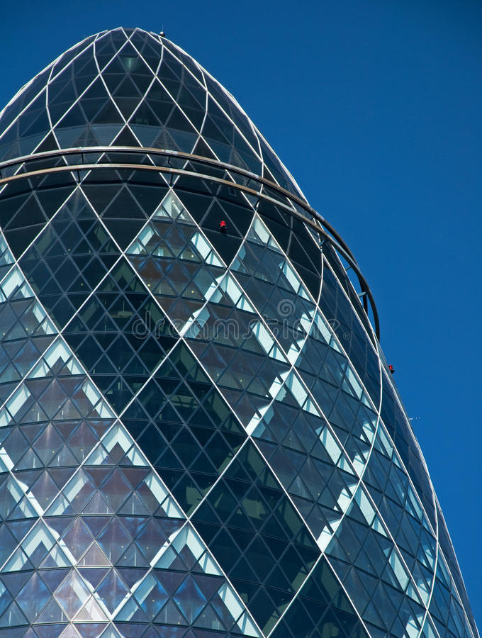 The top of the Gherkin Building. A view of the Gherkin building in London. 30 St Mary Axe (colloquially referred to as the Gherkin) is a skyscraper in Londons royalty free stock photo