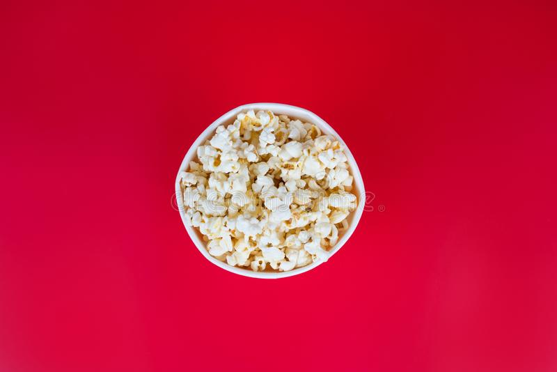 Top high angle above overhead close up view photo of small size bag with popcorn isolated over bright color background copyspace.  royalty free stock photography