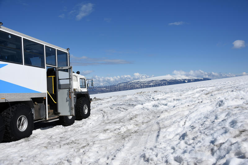 On top of Langjökull glacier. A special glacier truck brings you up to Langjokul glacier in Iceland where you can visit the largest man- made ice cave of the stock image