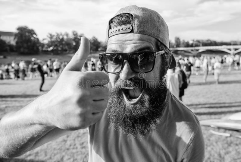 Top list summer festival must visit. Highly recommend top list. Hipster visiting event picnic fest or festival. Man. Cheerful face shows thumb up. Man bearded stock photos