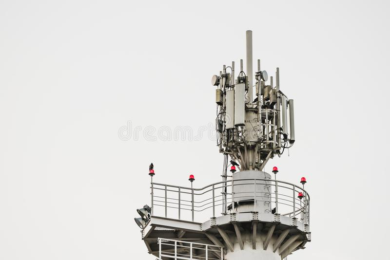 Top of metal tower with cellular antennas and observation deck royalty free stock images