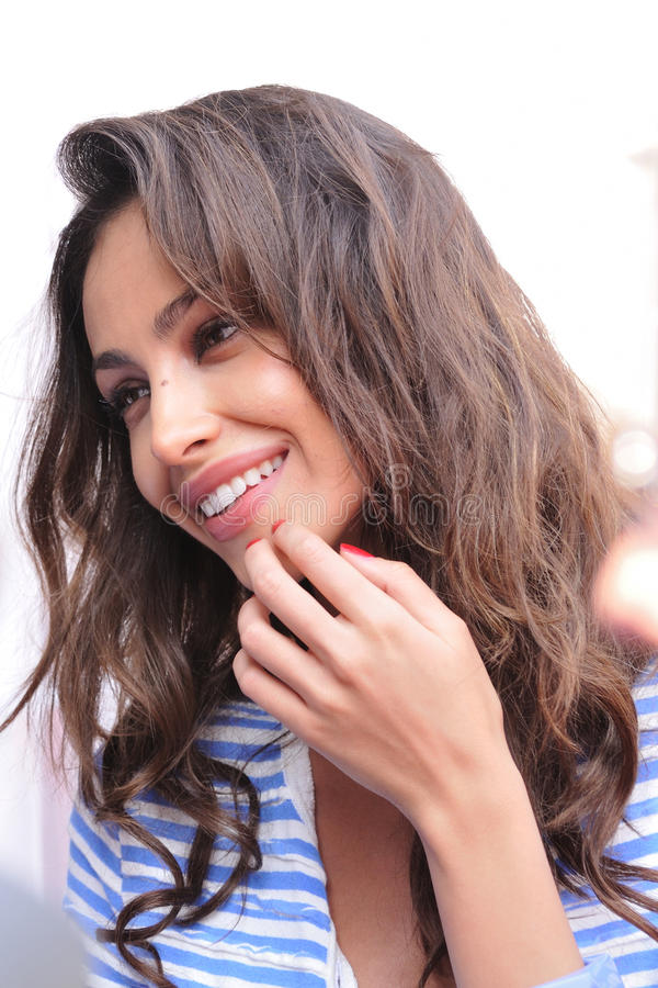 Top Model Madalina Ghenea at the 1000 Miglia. Brescia, Italy - May 12: Romanian Top Model Madalina Diana Ghenea is godmother of the 2011 edition of the 1000 royalty free stock photo