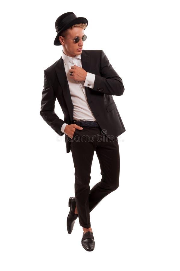 Top model maschio che posa per un manifesto fotografia stock