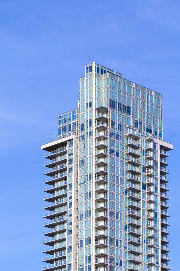 The top of a modern apartment building. With a blue sky background portrait royalty free stock image