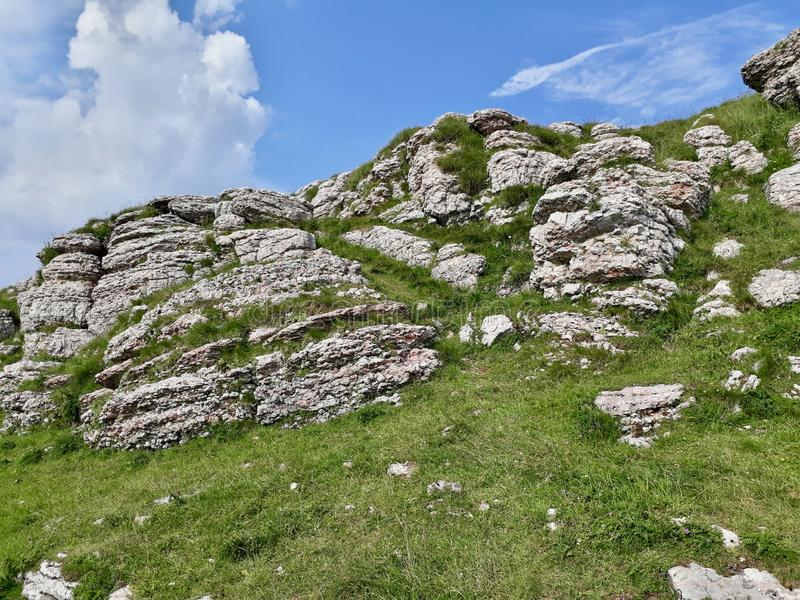 On top of Monte Baldo, Italy. A picture of some grass and rocks taken on the top of Monte Baldo mountain in Italy royalty free stock images